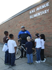 Bike officer talking with kids.png